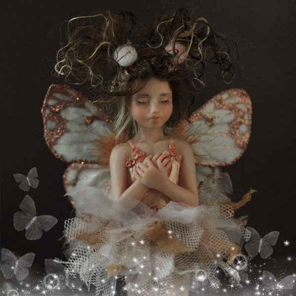 Dreaming Fairy with glitter wings and tutu dress.
