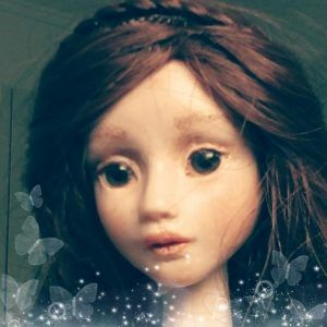 Sophija poseable doll from polymer clay with brown hair and eyes.