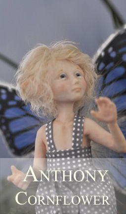 Blue Little Elfin boy with buttefly wings